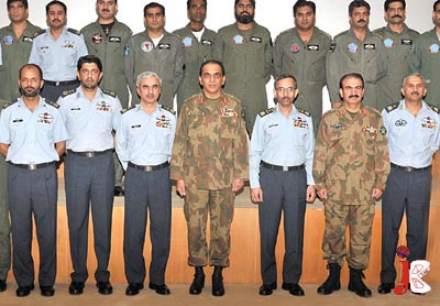 September 05: Chief of Army Staff General Ashfaq Parvez Kayani and Chief of Air Staff, Air Chief Marshal Rao Qamar Suleman pose for a group photo with the participants of Exercise Safron Bandit at PAF Airbase.
