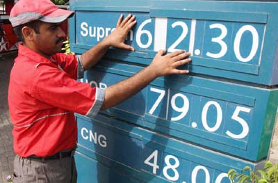 July, 01:  A worker of petrol pump changing the rate of petrol, Traders announced a nation wide strike to protest the hike in petrol price.