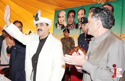 September 29:  Prime Minister Syed Yousaf Raza Gilani waves towards the audience during a public meeting in Gilgit.