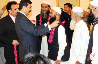 October 02: Prime Minister Syed Yousaf Raza Gilani greets the Pakistani citizens who were released from detention in a drug smuggling case in Saudi Arabia.
