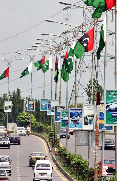 August 18: Pakistani National flags and PPP flags are hoisted upside down on the street light poles at Murree road in Islamabad