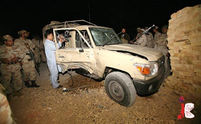 October 15: FC soldiers inspect a vehicle after a hand grenade attack on Saryab Road near Gahi Khan Chowk. 1 paramilitary soldier was martyred in the attack.