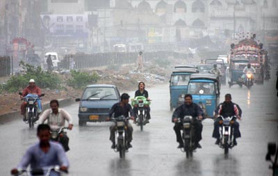 August 31:  Motorists move on the main road of Liaqatabad during heavy rain in the metropolis.