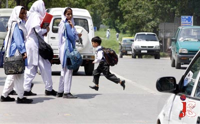 August 20: No room for error: A little boy crosses a road by running as there is no Zebra crossing near the government school at G-6/4 which is causing problems for the students