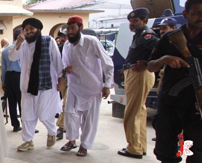 September 03: Former Member of National Assembly Shah Abdul Aziz flashes victory sign upon arrival for a hearing at Anti Terrorism Court in Rawalpindi
