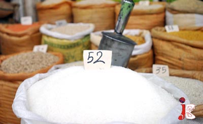 August 18: A shopkeeper displays the rate lists of different items at hi shop where he is selling sugar at the rate of Rs.52 per Kg at Kandhari Bazaar.