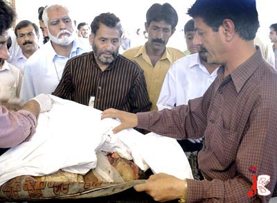 October 05: Pakistani paramedics examine the body of a victim of UN F-8/3 office blast at PIMS. The initial reports say that the blast took place inside the building's reception. A blast killed 4 persons including one foreigner who is reported Bhutan's nationalist and 4 other injured and they are in critical conditions at Pakistan Institute of Medical Sciences.