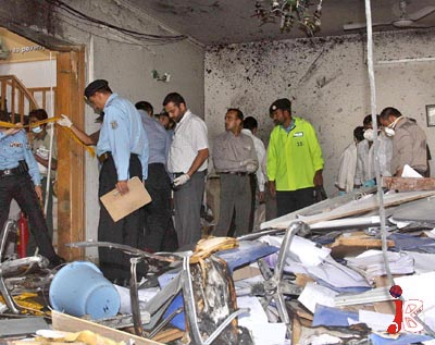 October 05: Pakistani security and agencies officials investigating and searching for the evidences at the site of a blast at UN Food Program office in F-8/3.