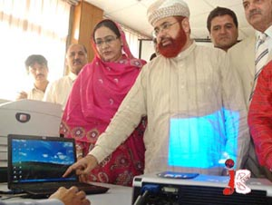 Federal Minister for Religious Affairs Hamid Saeed Kazmi presses the button for Hajj Draw